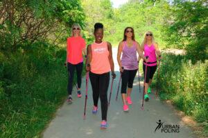 women walking with poles